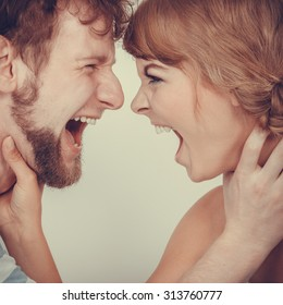relationship difficulties. Angry woman and man yelling at each other. Face to face. Fury couple