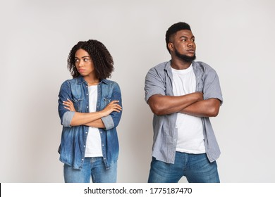 Relationship Problems. Offended African American Couple Ignoring Each Other After Argue, Standing With Folded Arms Over White Background, Copy Space