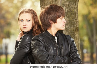 Relationship trouble or problem. Depressed woman and man in park