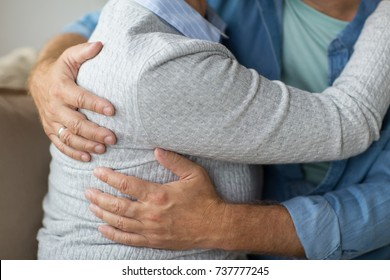 relationships, marriage and old people concept - close up of married senior couple hugging