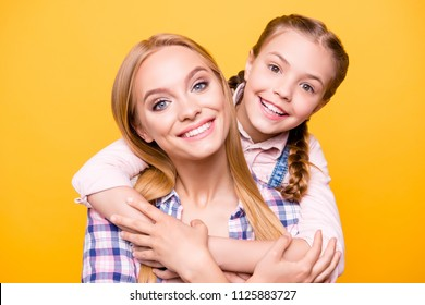 Relatives time siblings weekend home concept. Close up portrait of two cheerful honest cute lovely sweet beautiful mum and kid with pigtails hugging the neck laughing isolated on bright background