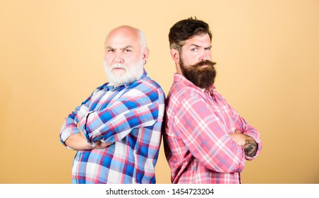 relatives. two bearded men senior and mature. youth vs old age compare. retirement. barbershop and hairdresser salon. father and son family. generational conflict. male beard care. checkered fashion.