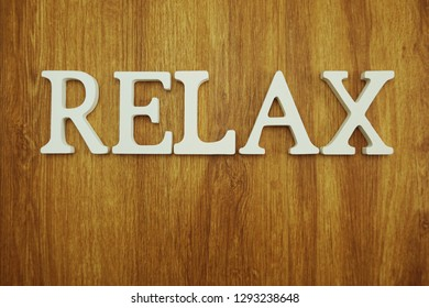 Relax alphabet letters on wooden background