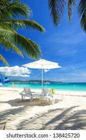 Relax area on beach with umbrella to shade from sunlight. Great for summer vacation background