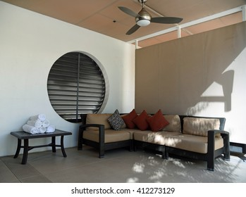 Relax area with sofa, fan and towels