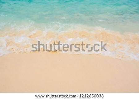 Relax and chill wallpaper. Blue sea, small wave and sand in sunny day.