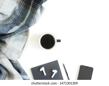 Relax with coffee and wireless in-ear headphones plus empty space for text. Scandinavian lifestyle.