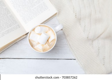 relax with a cup of coffee and a book. Flat lay