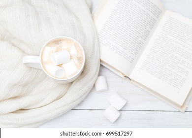 relax with a cup of coffee and a book. hygge style
