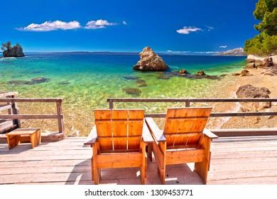 Relax deck chair by idyllic Adriatic beach, Punta Rata beach in Brela, Dalmatia, Croatia
