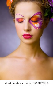 relax girl with closed-eyes, special makeup like butterfly