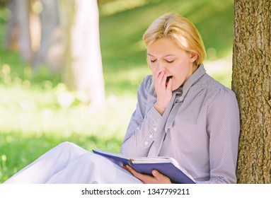 Relax leisure an hobby concept. Best self help books for women. Girl tired yawning sit park lean tree trunk read book. Reading inspiring books. Bestseller top list. Books every girl should read.