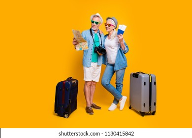 Relax leisure resort tourists journey visa honeymoon resort luggage agency concept. Full body size photo of two excited cheerful in glasses eyewear spectacles partners going abroad isolated background