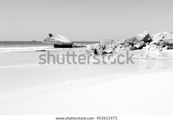 relax near sky in oman coastline sea ocean  gulf rock and beach