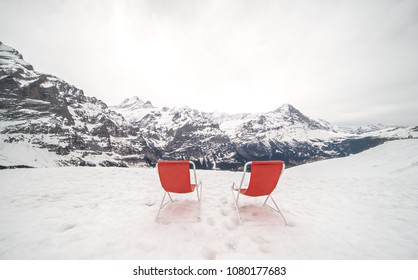 Relax on the beach chairs at the edge of the snow mountain cliff