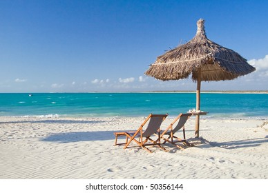 Relax on the beach, deck chair, parasol and lagoon