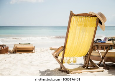 Relax on a chaise-longue. Armchair on the beach.