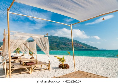 Relax on a luxury VIP beach with nice pavilion in a sunshine blue sky day