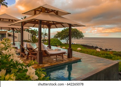 Relax on vacation at the pool area and which overlooks the  sunset in the beach and sea on a Maui Island  in Hawaii, USA.