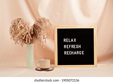 Relax, refresh, recharge, motivational quote on the letter board. Inspiration psycological text in the interior