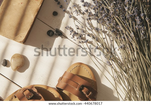 relax set with sandals lavender and book on white wood