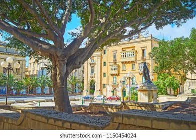 Relax in shade of lush park, situated on Robert Samut square in Floriana, Malta.
