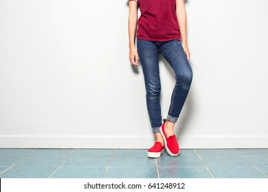 Relax style woman shoes,  pants, female shirt in hipster young asian girl style, slim body and standing.