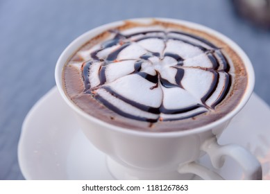 Relax time with hot cappuccino coffee in coffee cafe