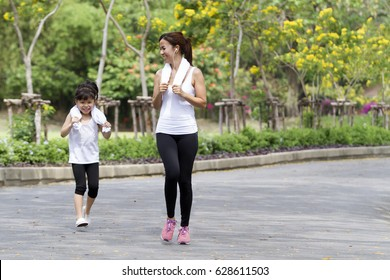 Relax time on summer,Daughter and mother jogging at park