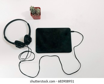 Relax time, tablet headphones with music on a white background.