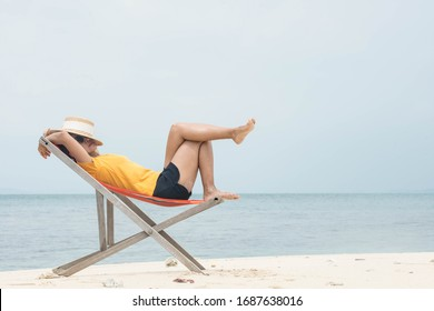 relax time Woman yellow shirt resting  on a beach chair