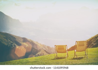 relax - two chairs in the mountains. Seceda Dolomites,  Italy.