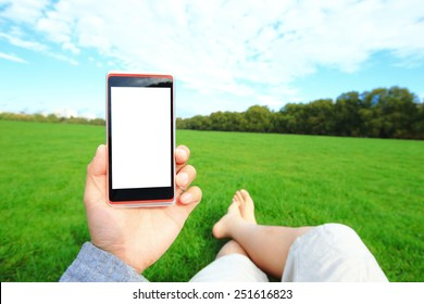 Relax using smart phone and barefoot enjoy nature in the green lawn,  Hyde Park in London, United Kingdom, UK