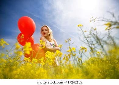 Relax woman with blue sky in yellow field