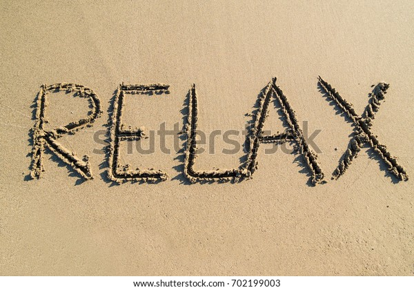 Relax word on beach - concept
