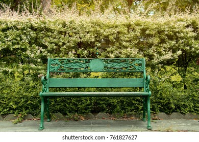 Relaxation concept : Long chair in the park : Long, classic, painted green in the park was placed in a park.