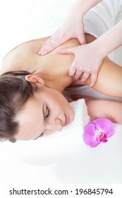 Relaxation during neck massage in spa, vertical