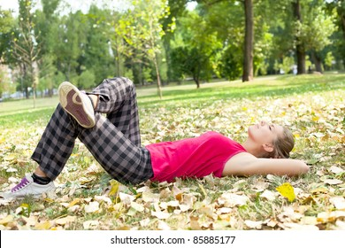 relaxation girl, young woman lying in park