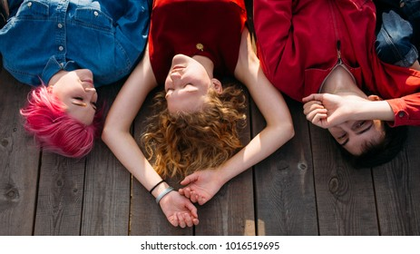 Relaxation meditation. Teenagers dream of future. Spiritual unity. Piece of mind. Carefree group of young diverse people daydreaming