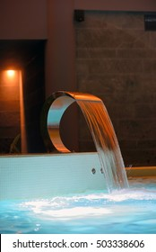 Relaxation pool in spa with waterfall