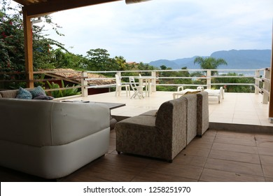 Relaxation room with armchairs with panoramic view of Ilhabela, Brazil