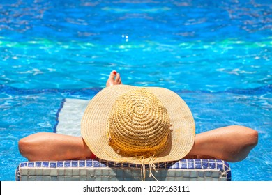 Relaxation at tropical swimming pool