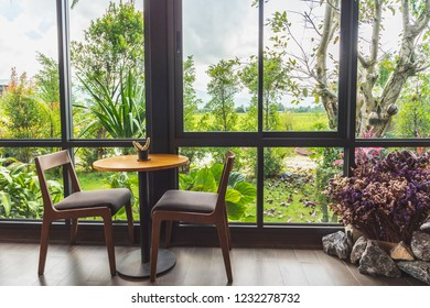 Relaxation zone with garden view. Living room for relax time.