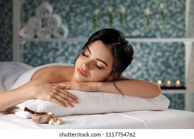 Relaxed beautiful young woman in spa salon. Beauty treatment