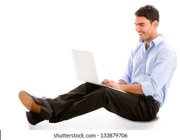 Relaxed business man working on a laptop - isolated over white