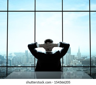 relaxed businessman sitting in office