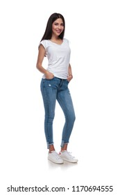 relaxed casual girl standing with hands in pockets on white background, full body picture