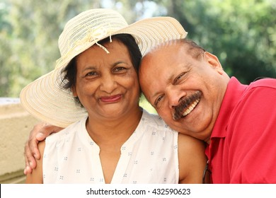 Relaxed close-up portrait of happily married, elderly Asian couple