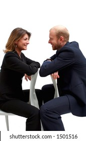 relaxed conversation between a business man and woman