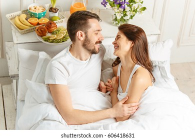 Relaxed Couple in Bed in bedroom at home